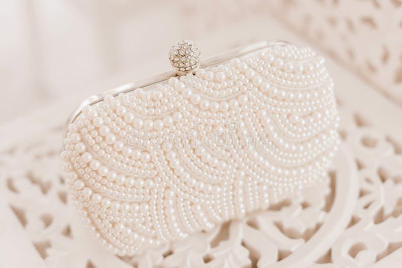 Fashionable wedding accessory. Pearl clutch handbag for an elegant bride royalty free stock photo