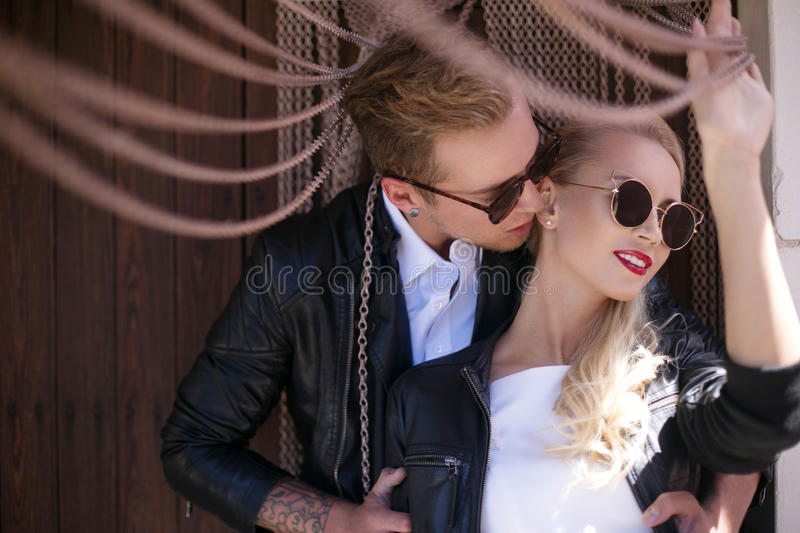 Fashionable wedding couple. Bride and Groom. Outdoor portrait royalty free stock photography