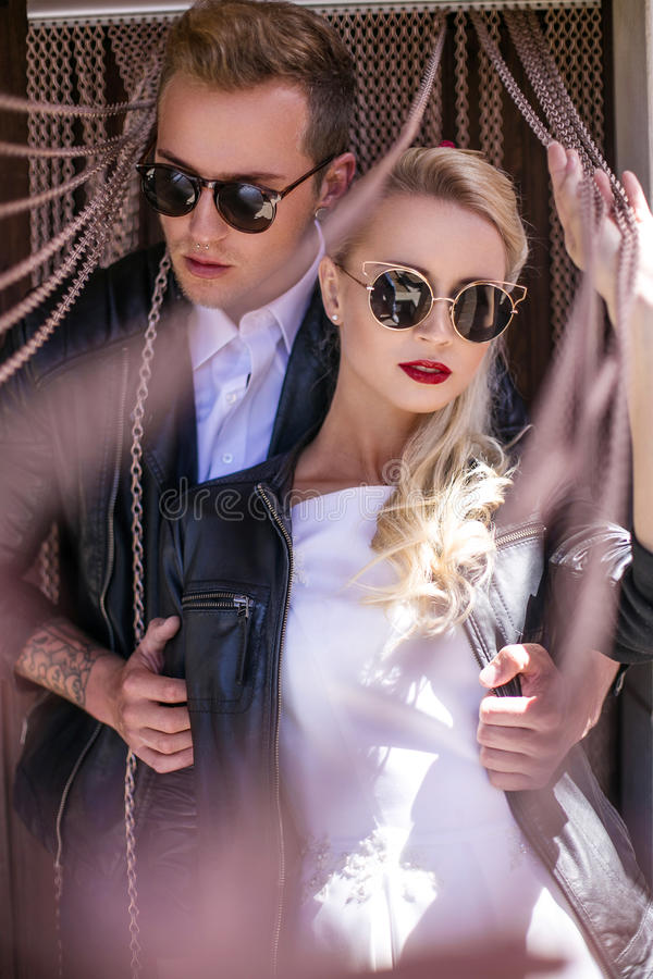 Fashionable wedding couple. Bride and Groom. Outdoor portrait royalty free stock image