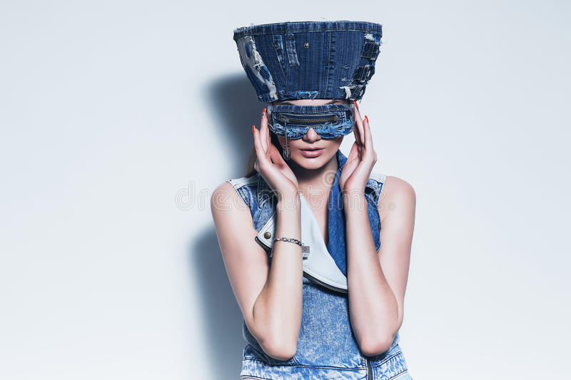 Fashionable woman in blue denim hat. In studio stock photography
