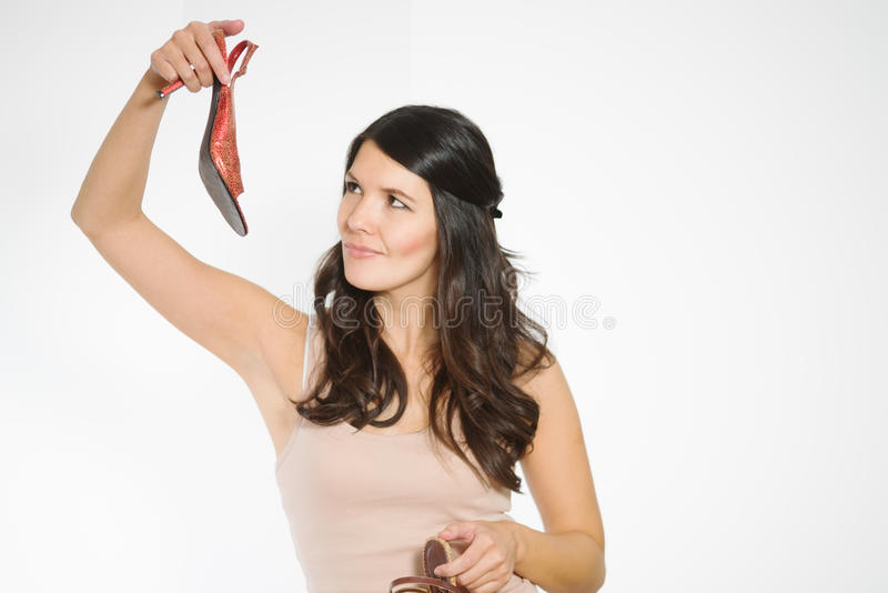 Fashionable woman choosing a pair of shoes royalty free stock photography