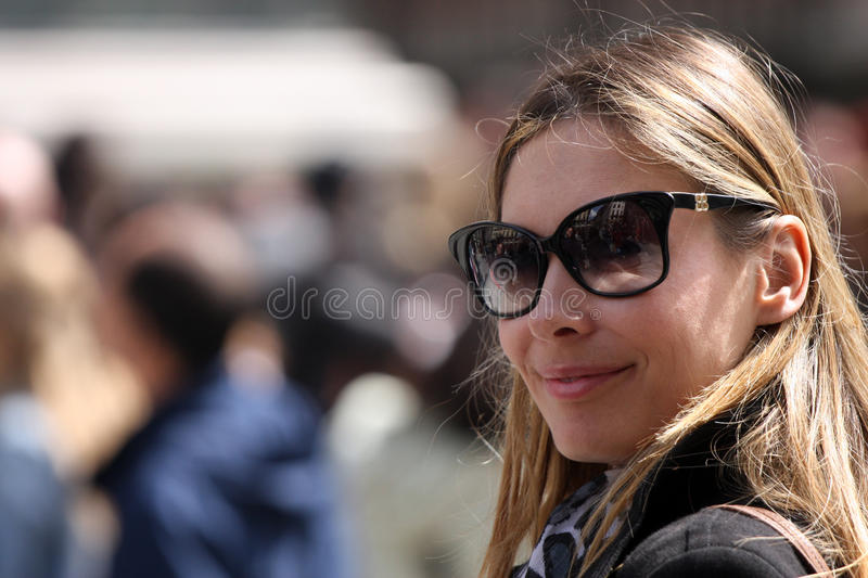 Fashionable and optimistic woman with sunglasses royalty free stock images