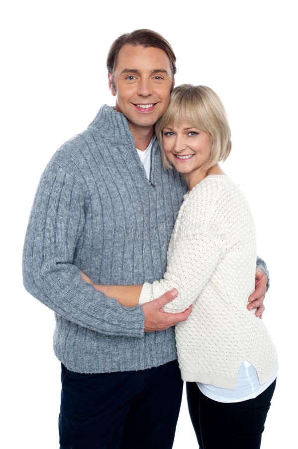 Fashionable woman hugging her loving husband stock photo