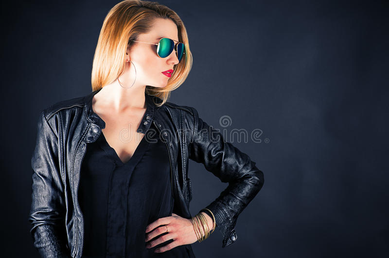 Fashionable woman in a jacket. Beautiful fashionable woman in a jacket royalty free stock photography