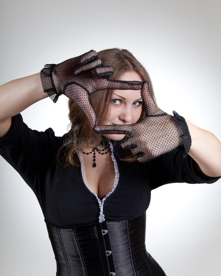 Fashionable woman making a frame with her hands stock photo