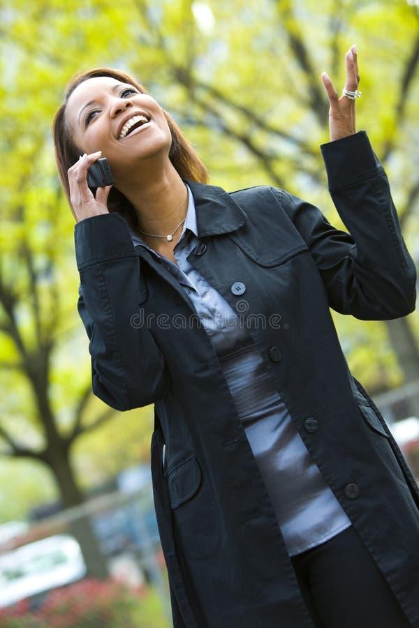 Fashionable woman on mobile stock image