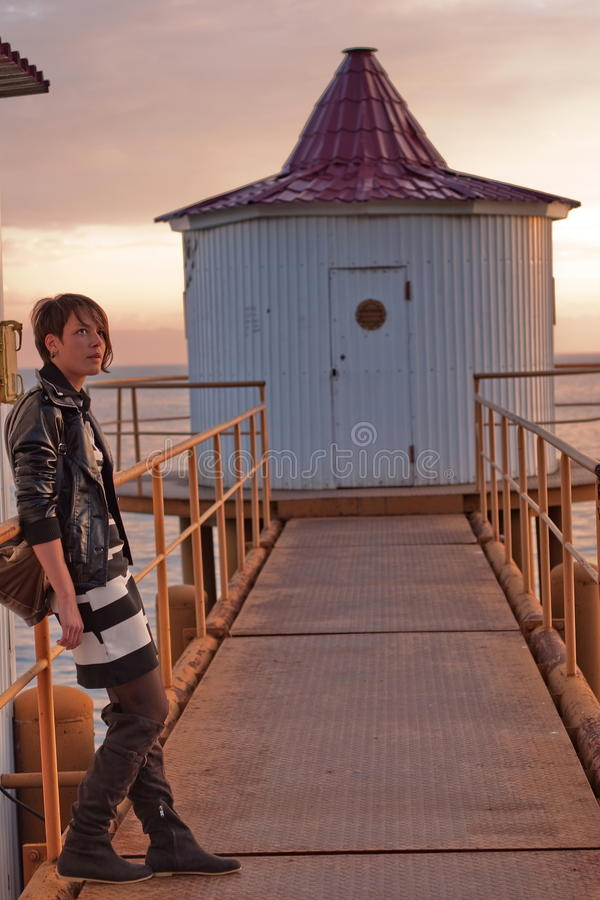 Fashionable woman on pier