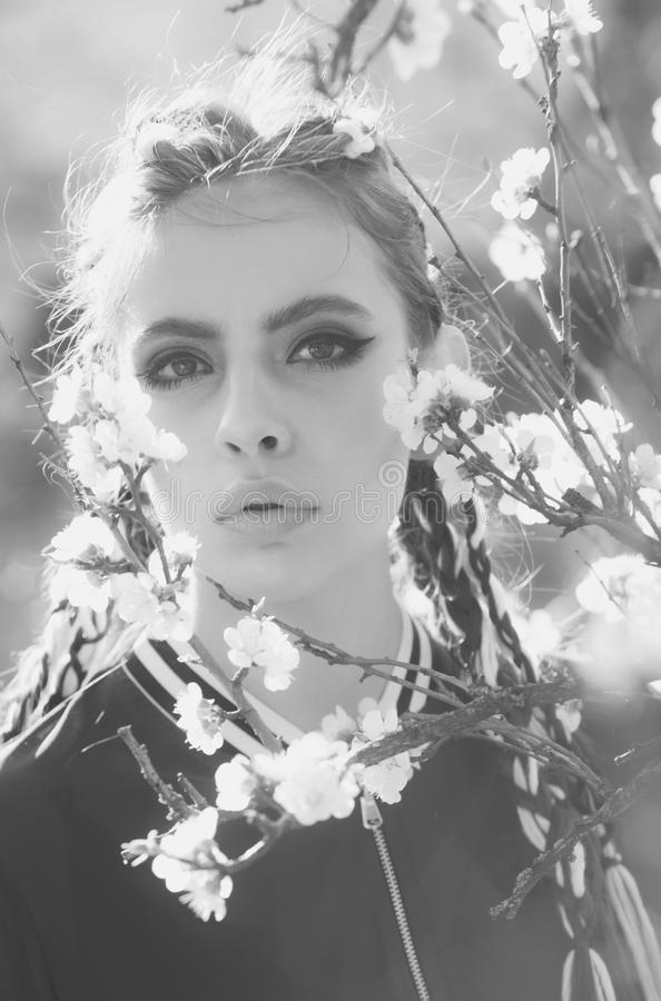 Fashionable woman posing. cherry tree spring blossom and beautiful girl in flowers. Fashionable woman posing. cherry tree spring blossom, beautiful girl or woman stock image