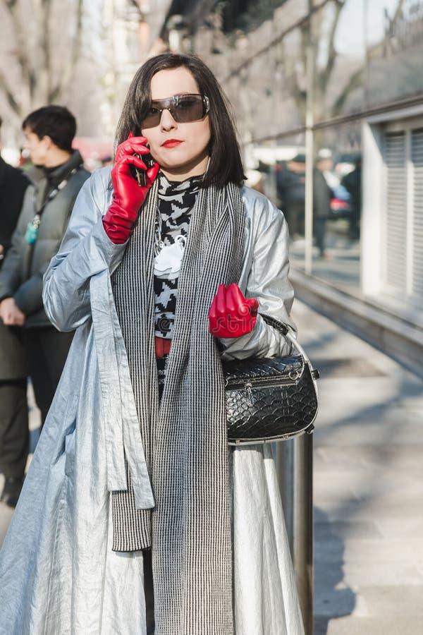 Fashionable woman posing during Milan Men`s Fashion Week stock photography