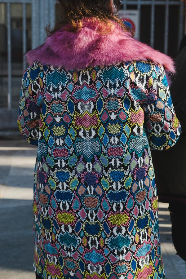 Fashionable woman posing during Milan Men`s Fashion Week stock photo