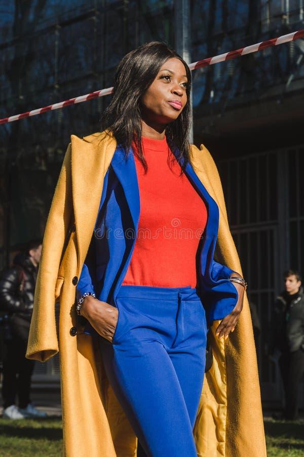Fashionable woman posing during Milan Men`s Fashion Week royalty free stock image