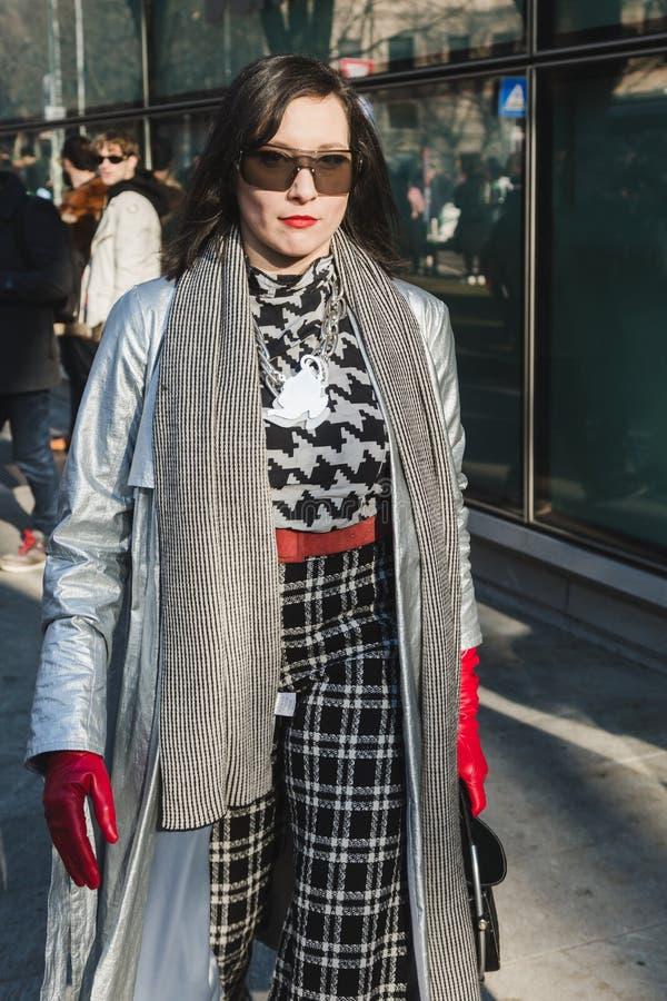 Fashionable woman posing during Milan Men`s Fashion Week royalty free stock photos