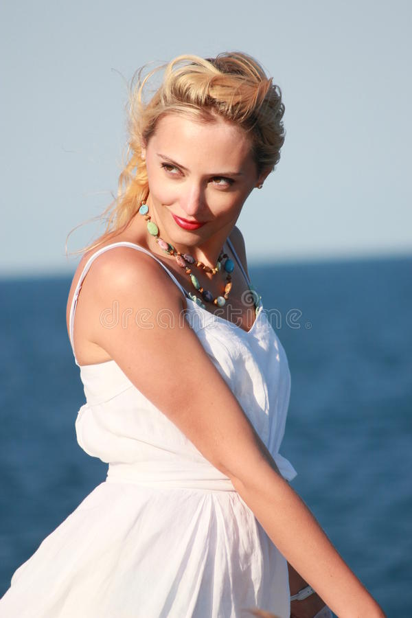 Fashionable woman by sea stock photos