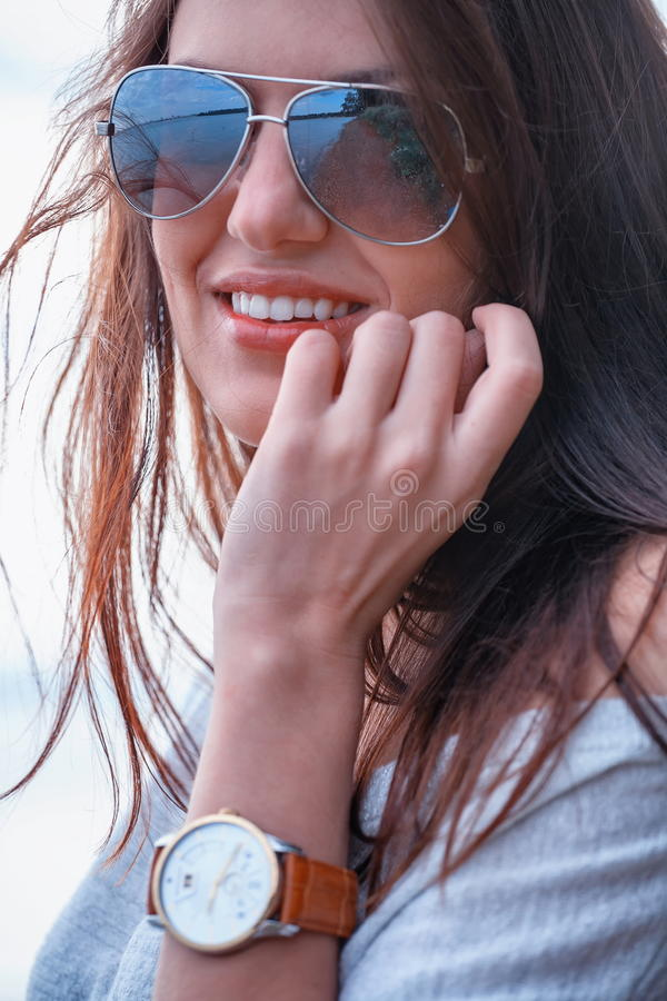 Fashionable woman in shades stock image