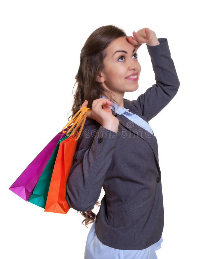Fashionable woman with shopping bags looking for special offers. On an isolated white background for cut out royalty free stock photos