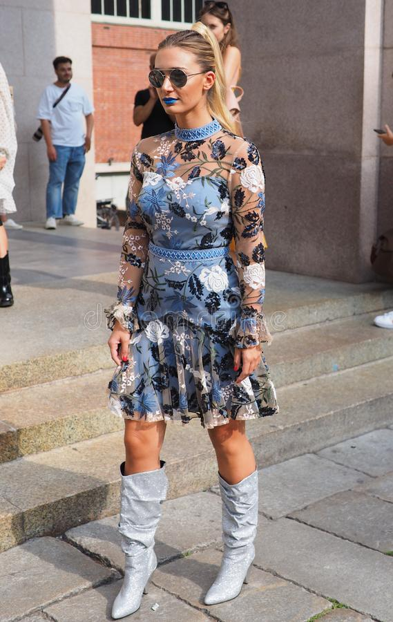 MILAN, Italy: 22 september 2018: Fashionable women in streetstyle outfit. Fashionable woman street style outfit before Philosophy di Lorenzo Serafini fashion stock photos