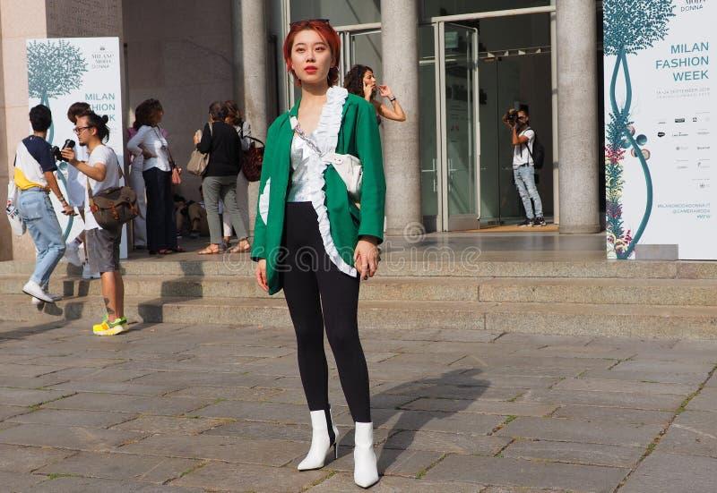 MILAN, Italy: 22 september 2018: Fashionable women in streetstyle outfit. Fashionable woman street style outfit before Philosophy di Lorenzo Serafini fashion stock photo