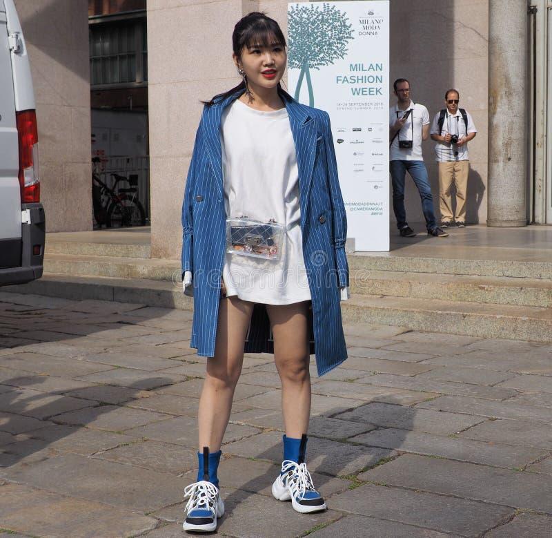 MILAN, Italy: 22 september 2018: Fashionable women in streetstyle outfit. Fashionable woman street style outfit before Philosophy di Lorenzo Serafini fashion royalty free stock image