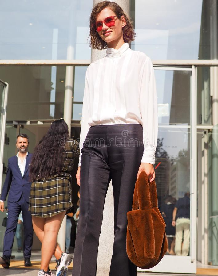 MILAN, Italy: September 22, 2018: Fashionable woman street style outfit. Fashionable woman street style outfit after Philosophy di Lorenzo Serafini fashion show royalty free stock photography