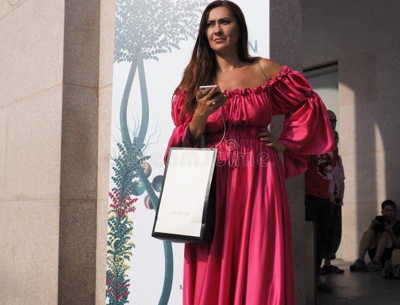 MILAN, Italy: 22 september 2018: Fashionable women in streetstyle outfit. Fashionable woman street style outfit before Philosophy di Lorenzo Serafini fashion stock photography