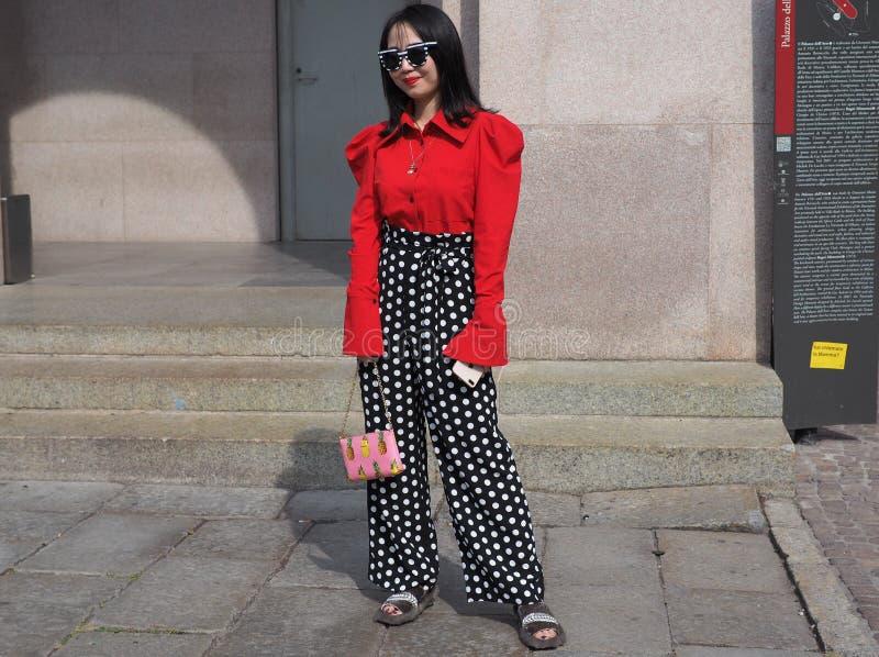 MILAN, Italy: 22 september 2018: Fashionable woman in streetstyle outfit. Fashionable woman street style outfit before Philosophy di Lorenzo Serafini fashion royalty free stock photo