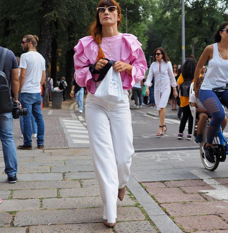 MILAN, Italy: September 22, 2018: Fashionable woman street style outfit. Fashionable woman street style outfit after Philosophy di Lorenzo Serafini fashion show royalty free stock image
