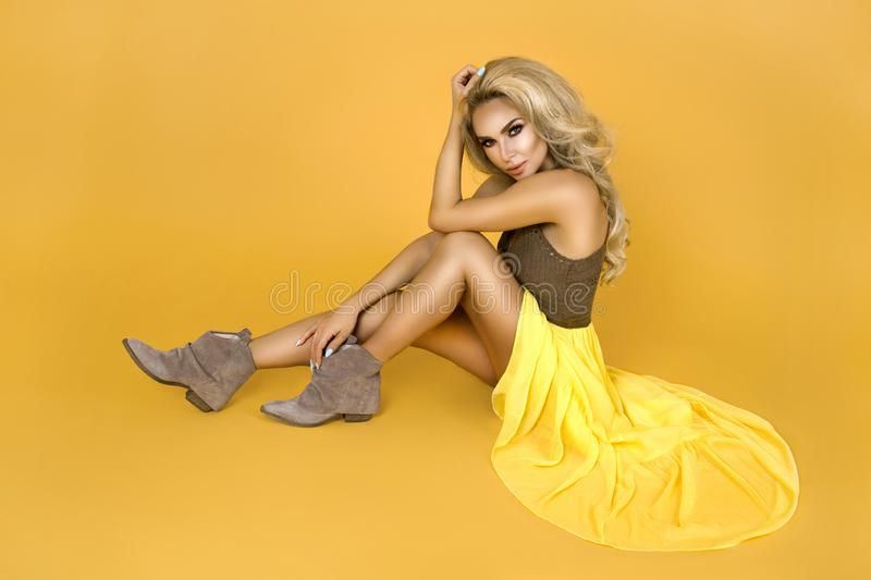 Fashionable woman in trendy yellow dress, shoes and accessories. Fashion spring summer photo. Country girl - Image. Fashionable woman model in trendy yellow royalty free stock photo