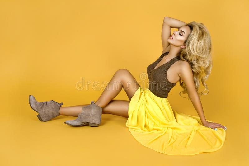 Fashionable woman in trendy yellow dress, shoes and accessories. Fashion spring summer photo. Country girl - Image. Fashionable woman model in trendy yellow stock image