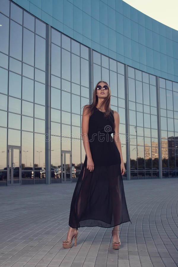 Fashionable woman on urban background royalty free stock image