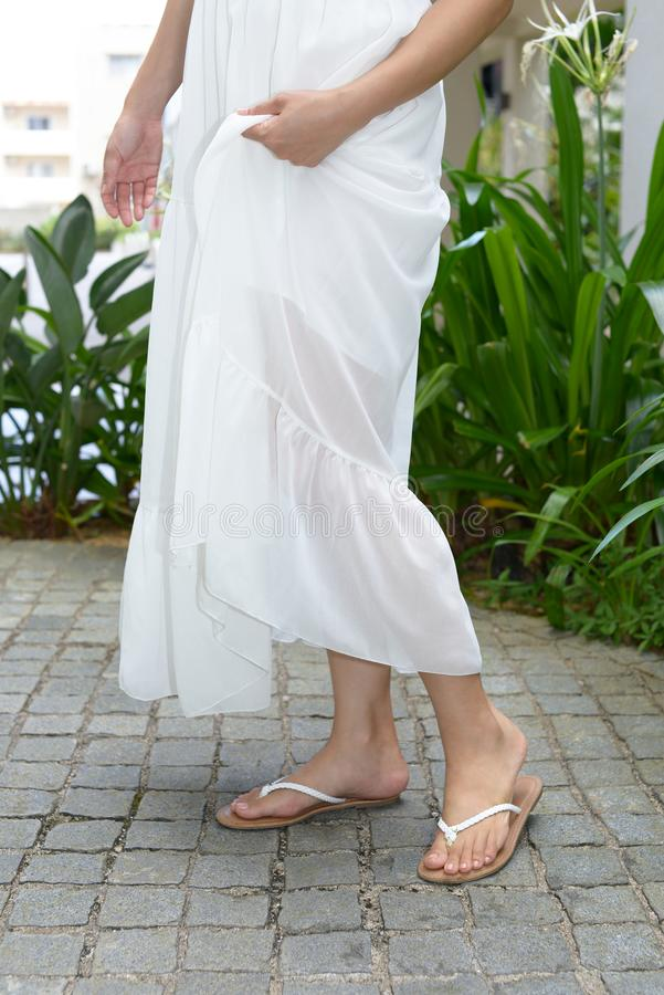 Woman wearing summer dress. Fashionable woman wearing white summer dress royalty free stock image