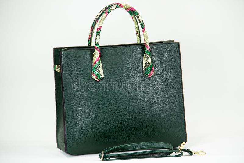 Fashionable women bag. Green lether fashionable women bag royalty free stock photo