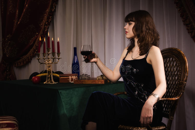 Fashionable women with red wine glass stock photos