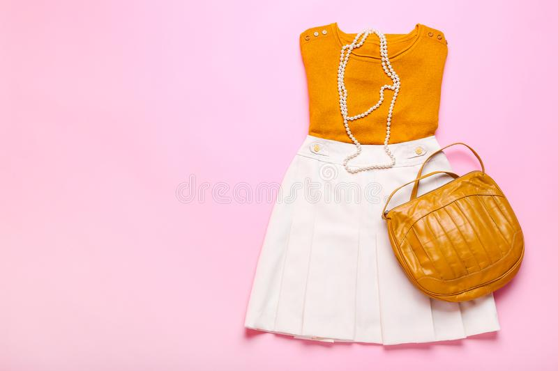 Fashionable women`s clothes. On pink background stock photography