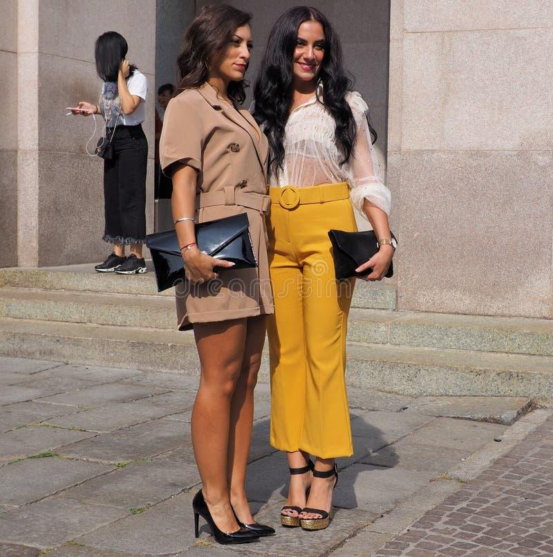 MILAN, Italy: 22 september 2018: Fashionable women in streetstyle outfit. Fashionable women street style outfit before Philosophy di Lorenzo Serafini fashion stock image