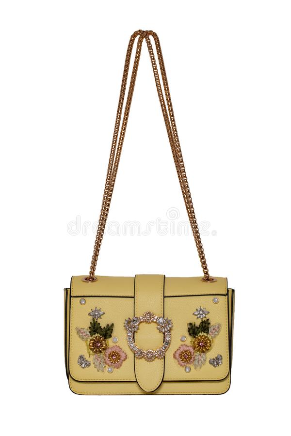 Fashionable yellow female luxury women bag isolated on a white background. Fashionable womans accessories royalty free stock images