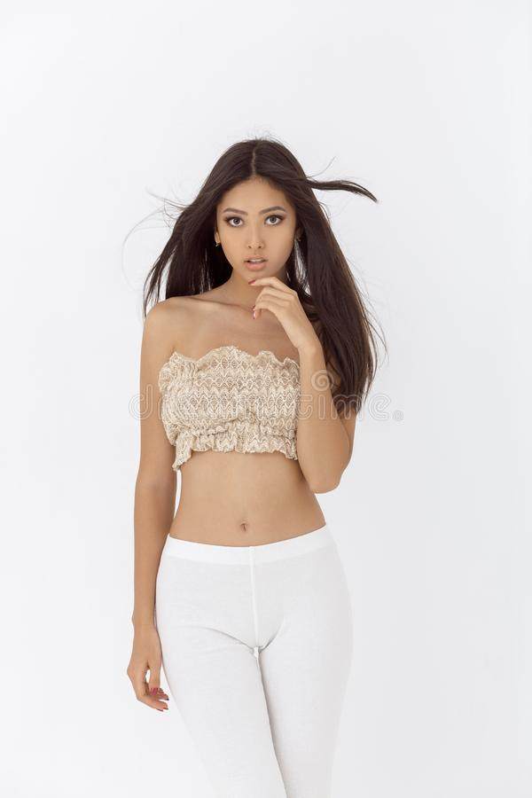 Fashionable young asian woman indoors in studio royalty free stock photo