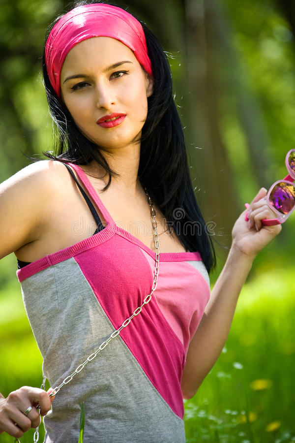 Fashionable Young Brunette With Sunglasses Royalty Free Stock Photography