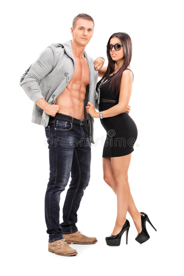 Fashionable young couple posing royalty free stock photos