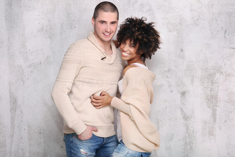 Fashionable young couple posing. royalty free stock image