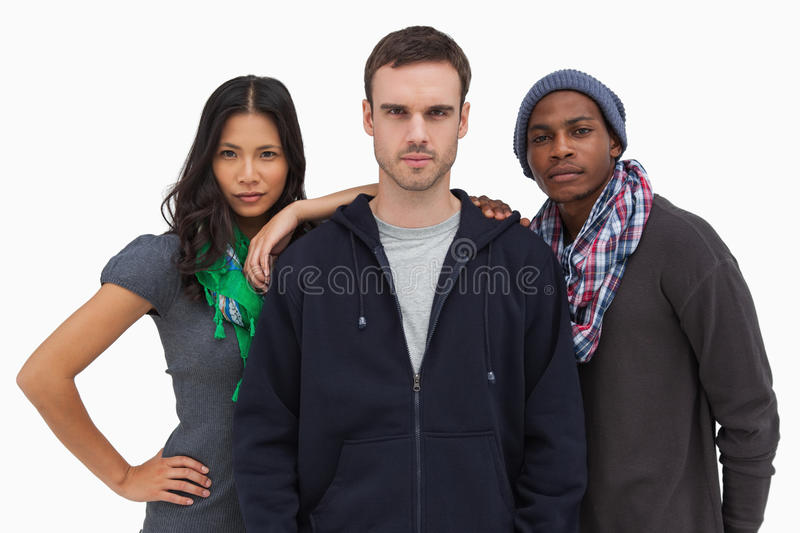 Fashionable young friends looking at camera. On white background stock images