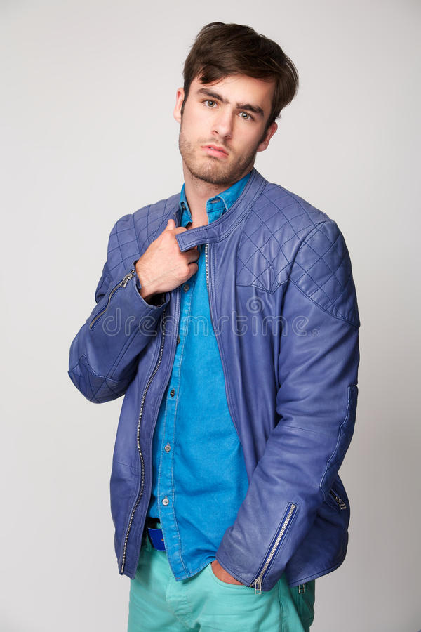Fashionable young man with colorful clothing royalty free stock photos