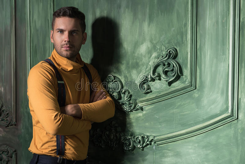 Fashionable young man posing confidently stock images