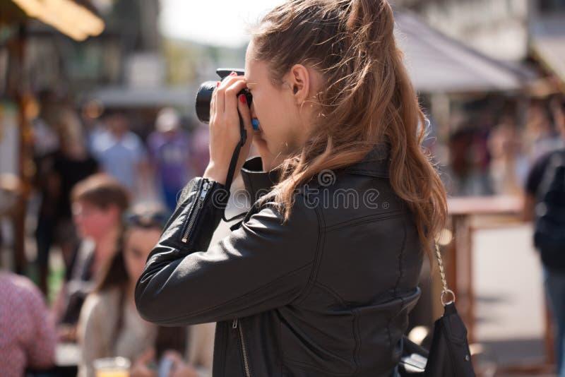 Fashionable young photographer. stock photography