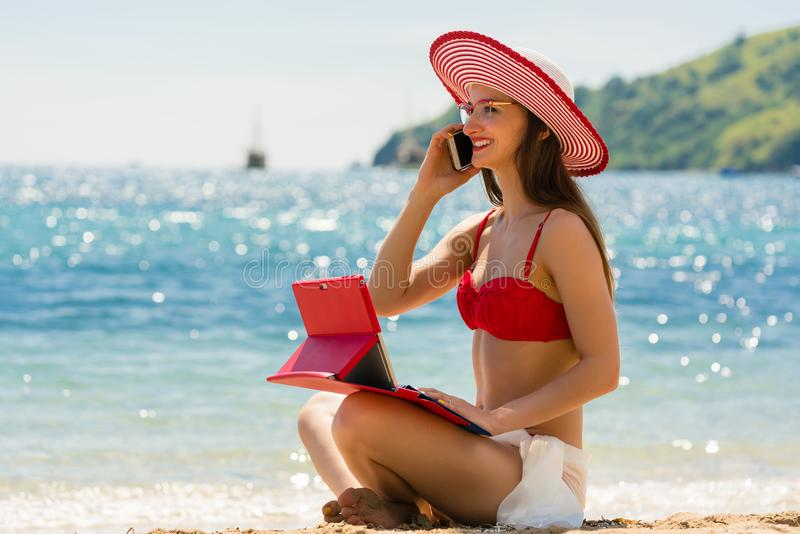 Fashionable young woman on the beach royalty free stock image