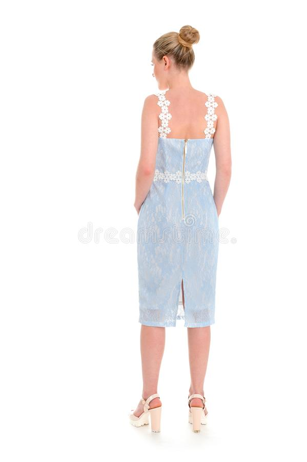 Fashionable young woman in beautiful blue dress posing at studio royalty free stock image