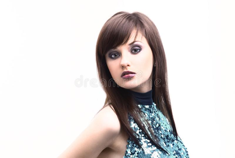 Fashionable young woman in pretty dress posing in the Studio. royalty free stock photo