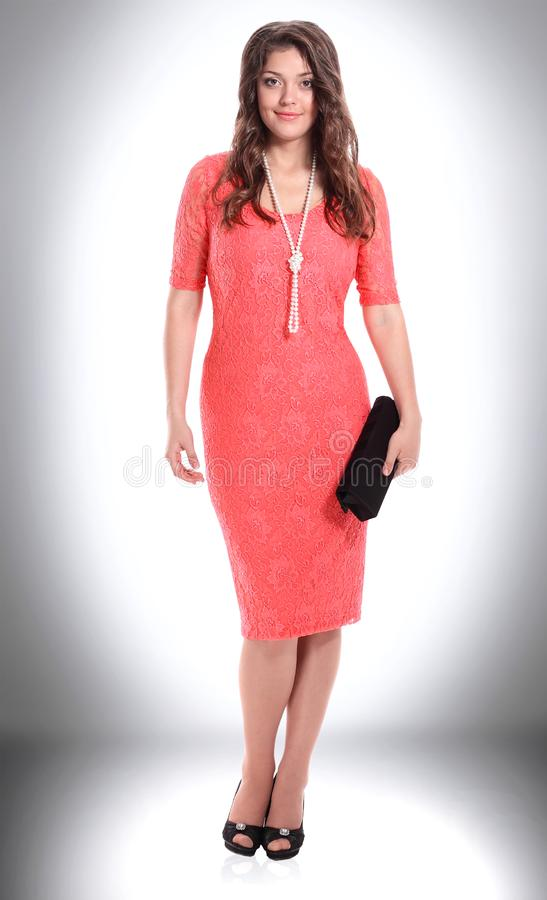 Fashionable young woman in fashionable red dress . royalty free stock images
