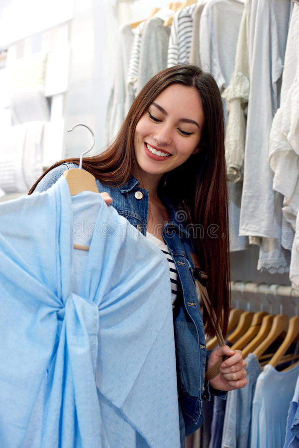 Fashionable young woman shopping at boutique royalty free stock images