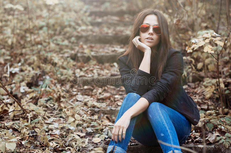 Fashionable young woman in sunglasses royalty free stock photos
