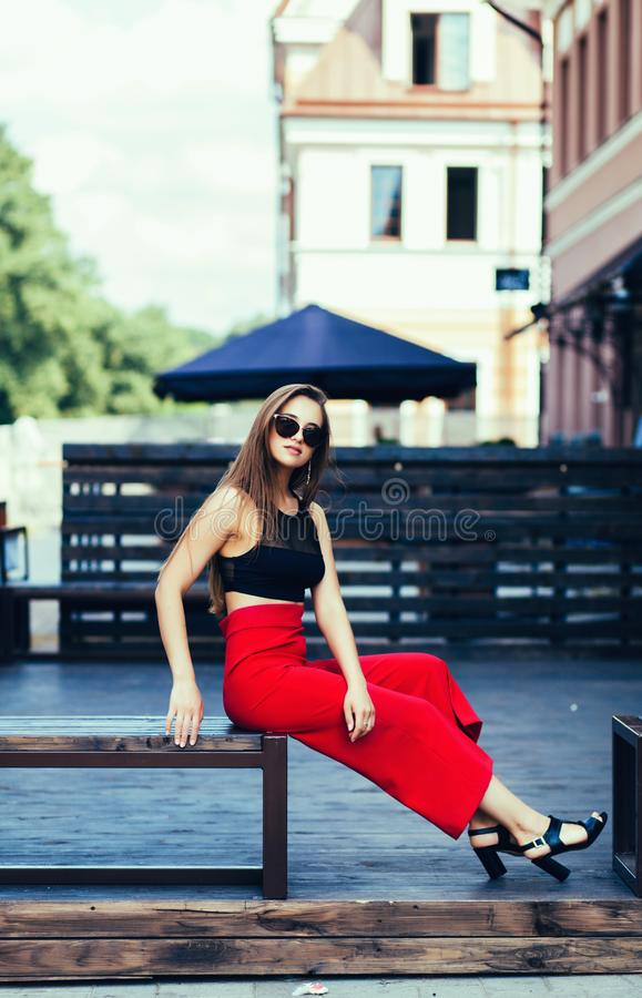 Fashionable young woman in sunglasses stock photos